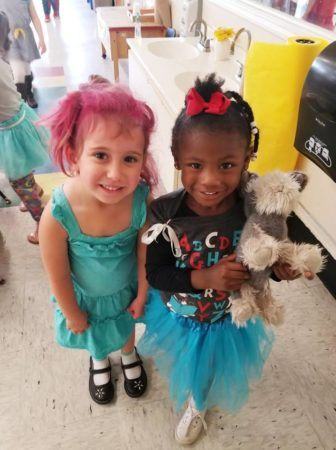preschool_girls_smiling_for_the_camera_cadence_academy_preschool_charleston_sc-336x450