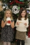 preschool_girls_with_milk_and_cookies_for_santa_cadence_academy_preschool_steele_creek_charlotte_nc-300x450