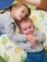 preschool_siblings_cuddling_winwood_childrens_center_ashburn_va-338x450