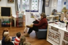 preschool_teacher_reading_book_to_preschoolers_winwood_childrens_center_leesburg_va-675x450