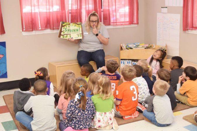 preschool_teacher_reading_shhh_book_cadence_academy_preschool_mauldin_sc-675x450