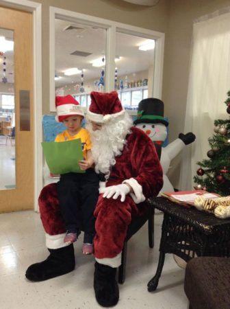 preschooler_and_santa_cadence_academy_raintree_charlotte_nc-336x450