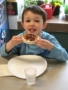 preschooler_eating_healthy_rice_cake_and_fruit_winwood_childrens_center_reston_va-338x450
