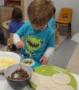 preschooler_making_a_taco_childrens_garden_montessori_richland_wa-395x450