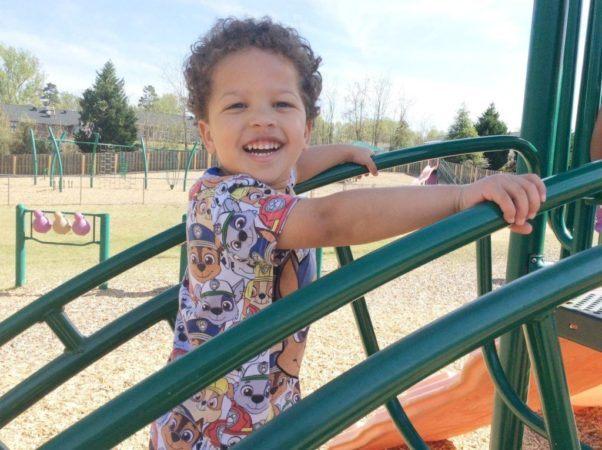 preschooler_on_playground_cadence_academy_northlake_charlotte_nc-1024x765-602x450