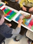 preschooler_playing_with_balls_of_ice_winwood_childrens_center_gainesville_va-338x450