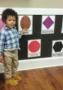 preschooler_pointing_at_an_oval_sunbrook_academy_at_chapel_hill_douglasville_ga-316x450