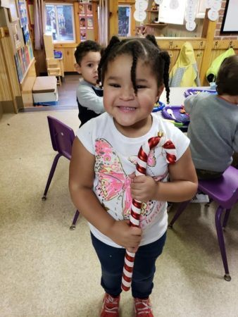 preschooler_with_large_candy_cane_cadence_academy_preschool_portland_or-338x450