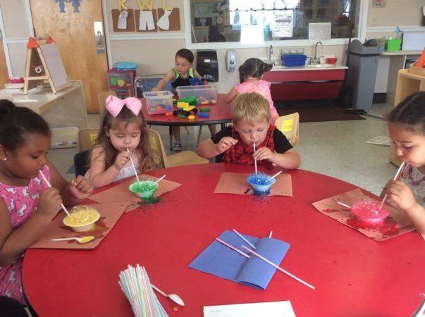 preschoolers_blowing_colored_bubbles_cadence_academy_preschool_surfside_myrtle_beach_sc-603x450
