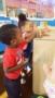 preschoolers_coloring_cardboard_box_cadence_academy_preschool_surfside_myrtle_beach_sc-253x450