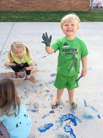 preschoolers_enjoying_outdoor_painting_activity_toddlers_enjoying_halloween_cadence_academy_preschool_greensboro_nc-335x450