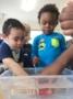 preschoolers_enjoying_water_play_at_cadence_academy_preschool_northeast_columbia_sc-336x450