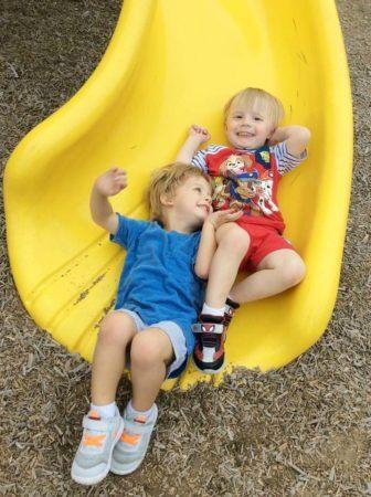 preschoolers_going_down_slide_at_cadence_academy_preschool_myrtle_beach_sc-336x450