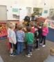 preschoolers_looking_at_fireman_gear_carolina_kids_child_development_center_fort_mill_sc-393x450