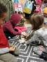preschoolers_petting_rabbit_cadence_academy_preschool_portland_or-338x450