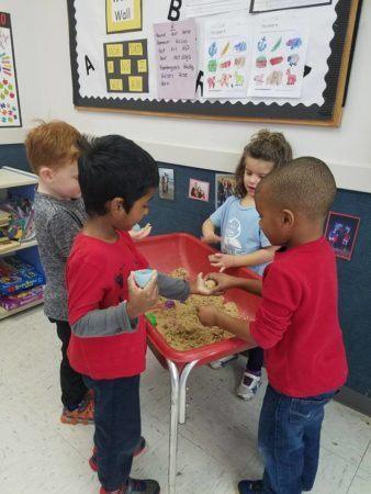 preschoolers_playing_in_sand_winwood_childrens_center_fairfax_va-338x450