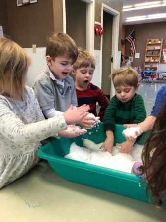 preschoolers_playing_with_snow_in_tub_jonis_child_care_preschool_canton_ct-338x450