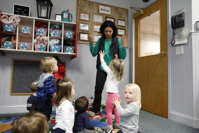 preschoolers_playing_with_teacher_winwood_childrens_center_leesburg_va-675x450