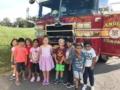 preschoolers_posing_in_front_of_fire_engine_winwood_childrens_center_brambleton_ii_va-601x450