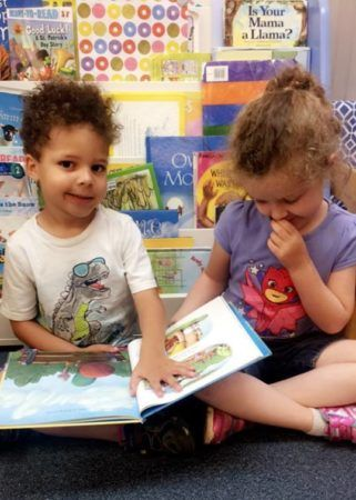 preschoolers_reading_a_book_winwood_childrens_center_gainesville_va-321x450
