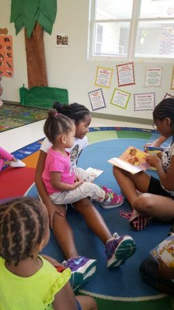 preschoolers_reading_together_cadence_academy_northlake_charlotte_nc-253x450