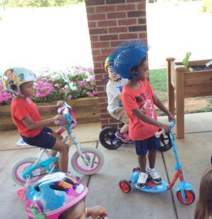 preschoolers_wearing_helmets_cadence_academy_northlake_charlotte_nc-993x1024-436x450