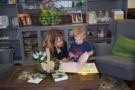 reading_a_book_in_the_lobby_at_cadence_academy_preschool_rogers_ar-675x450