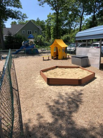 sand_pit_and_play_house_outside_cadence_academy_preschool_north_attleborough_ma-338x450