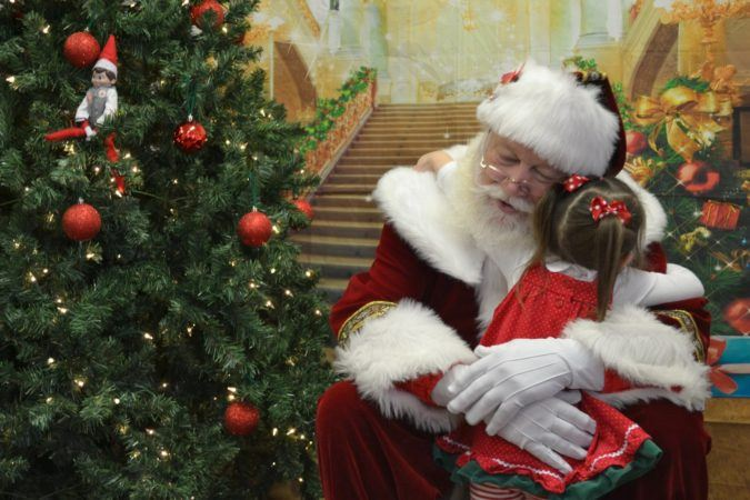 santa_giving_preschool_girl_a_hug_winwood_childrens_center_fairfax_va-675x450