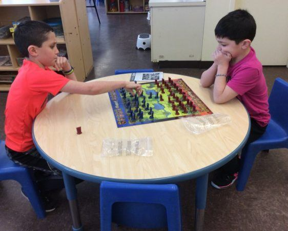 school_age_children_playing_risk_cadence_academy_preschool_ridgefield_ct-562x450