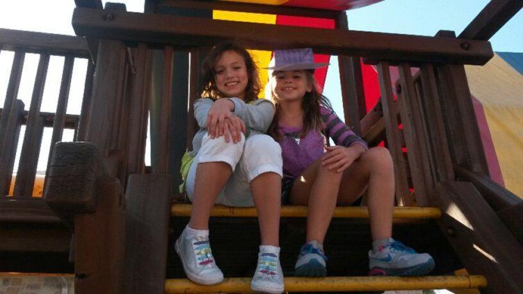 school_age_girls_on_playground_equipment_cadence_academy_preschool_allen_tx-752x423
