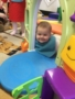 silly_toddler_smiling_at_play_door_cadence_academy_preschool_east_greenwich_ri-338x450