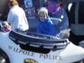 sitting_on_police_bike_at_next_generation_childrens_centers_walpole_ma-600x450