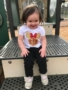 smiling_little_girl_on_playground_at_sunbrook_academy_at_woodstock_ga-338x450