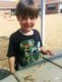 smiling_preschool_boy_on_playground_at_cadence_academy_preschool_surfside_myrtle_beach_sc-338x450