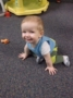 smiling_toddler_crawling_cadence_academy_preschool_kays_normal_il-336x450