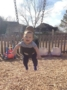 smiling_toddler_in_swing_at_cadence_academy_preschool_summerville_sc-333x450