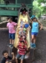 summer_campers_enjoying_slide_at_the_zoo_the_peanut_gallery_temple_tx-333x450