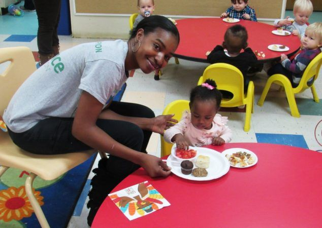 teacher_and_toddler_enjoying_meal_at_cadence_academy_preschool_harbison_columbia_sc-634x450