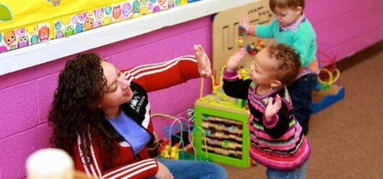 teacher_and_toddler_high_fiving_prime_time_early_learning_centers_middletown_ny-752x353