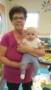 teacher_holding_toddler_winwood_childrens_center_gainesville_va-253x450