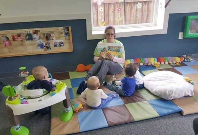 teacher_reading_book_to_toddlers_winwood_childrens_center_fairfax_va-657x450