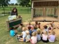 teacher_reading_to_preschoolers_outside_at_cadence_academy_preschool_rogers_ar-603x450
