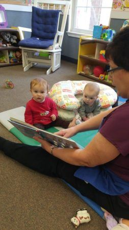 teacher_reading_to_toddlers_winwood_childrens_center_gainesville_va-253x450