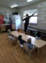 teacher_showing_2-year-olds_how_to_count_miss_muffets_learning_center_klamath_falls_or-330x450