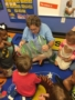 teacher_showing_butterfly_to_students_faith_preschool_academy_southaven-338x450