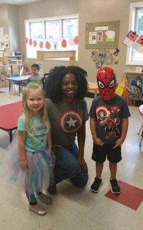 teacher_with_spiderman_and_supergirl_at_cadence_academy_raintree_charlotte_nc-279x450