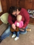 toddler_and_teacher_playing_guitar_cadence_academy_preschool_urbandale_ia-333x450