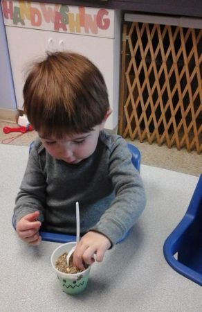 toddler_boy_eating_a_snack_prime_time_early_learning_centers_middletown_ny-292x450