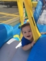 toddler_boy_enjoying_bounce_house_prime_time_early_learning_centers_farmingdale_ny-338x450